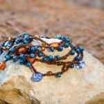 Teal orange brown beaded ve..