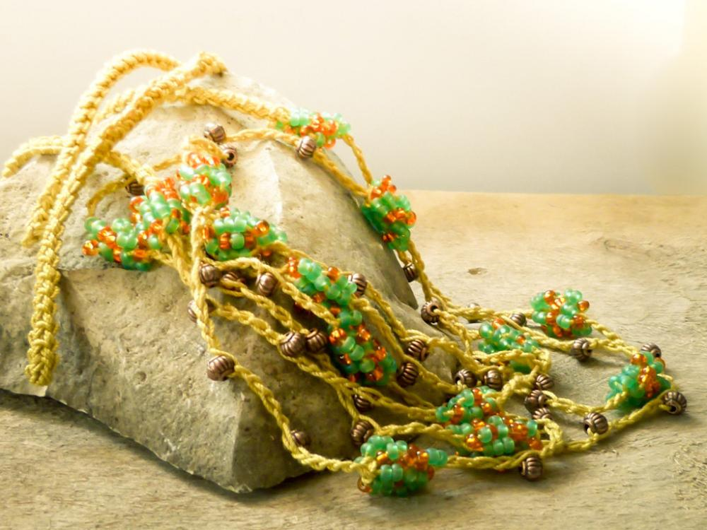 Spring fashion. Mustard orange green versatile beaded crochet strand wrap braselet. Natural history