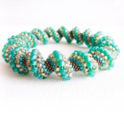 Spring teal green peach turquoise bronze beaded Cellini spiral bracelet. fashion jewelry
